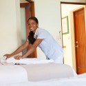 Housekeeper Folding in a Guest Room